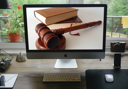 Gavel and Law Books on Computer Screen